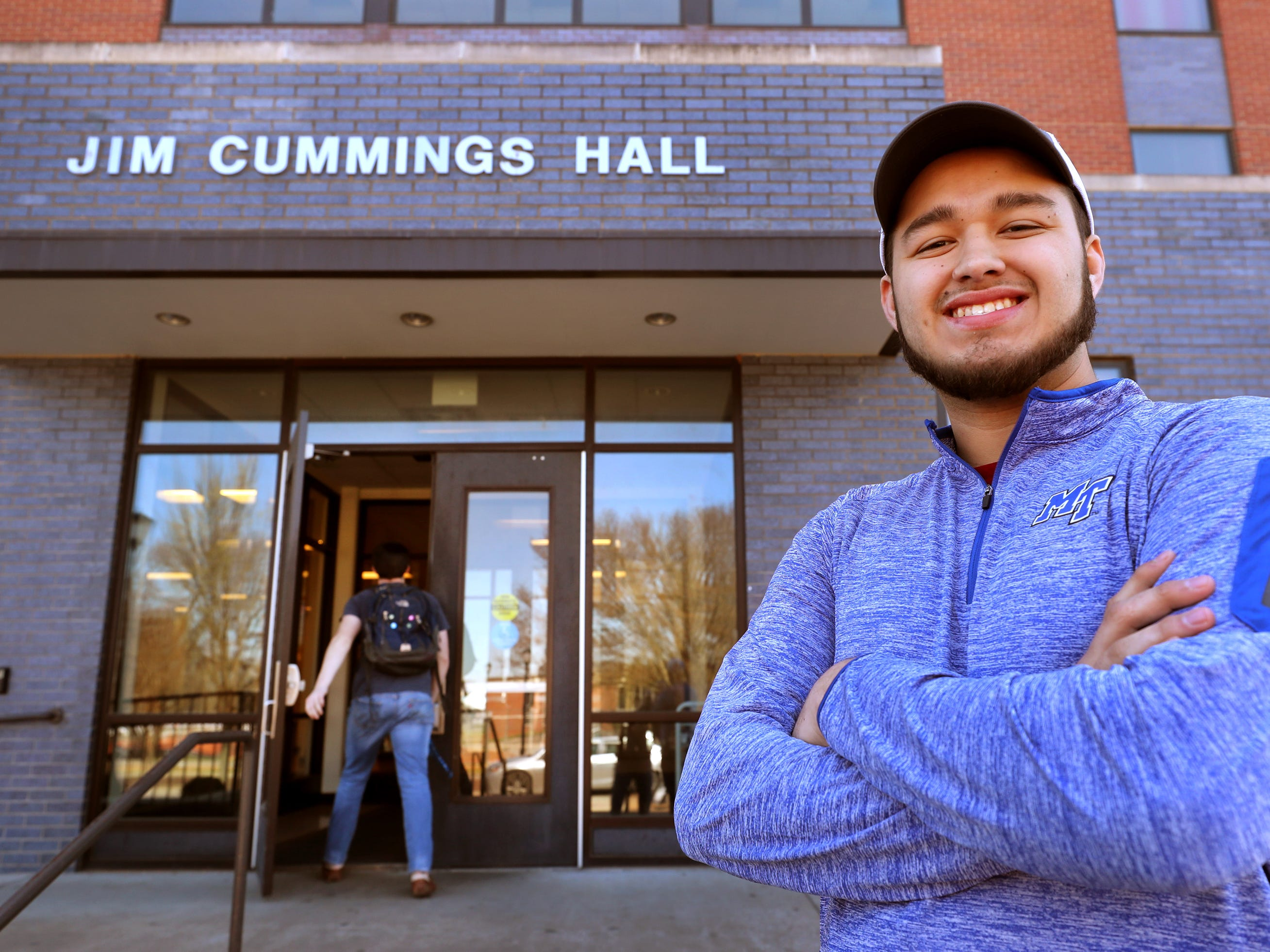 MTSU freshman Isaac Plata stands in front of his dorm, Jim Cummings Hall, at MTSU on Friday, March 22, 2019. Plata, who was once homeless, was able to participate in a program at MTSU that makes it easier for former homeless individuals to have a dorm room, while attending college.