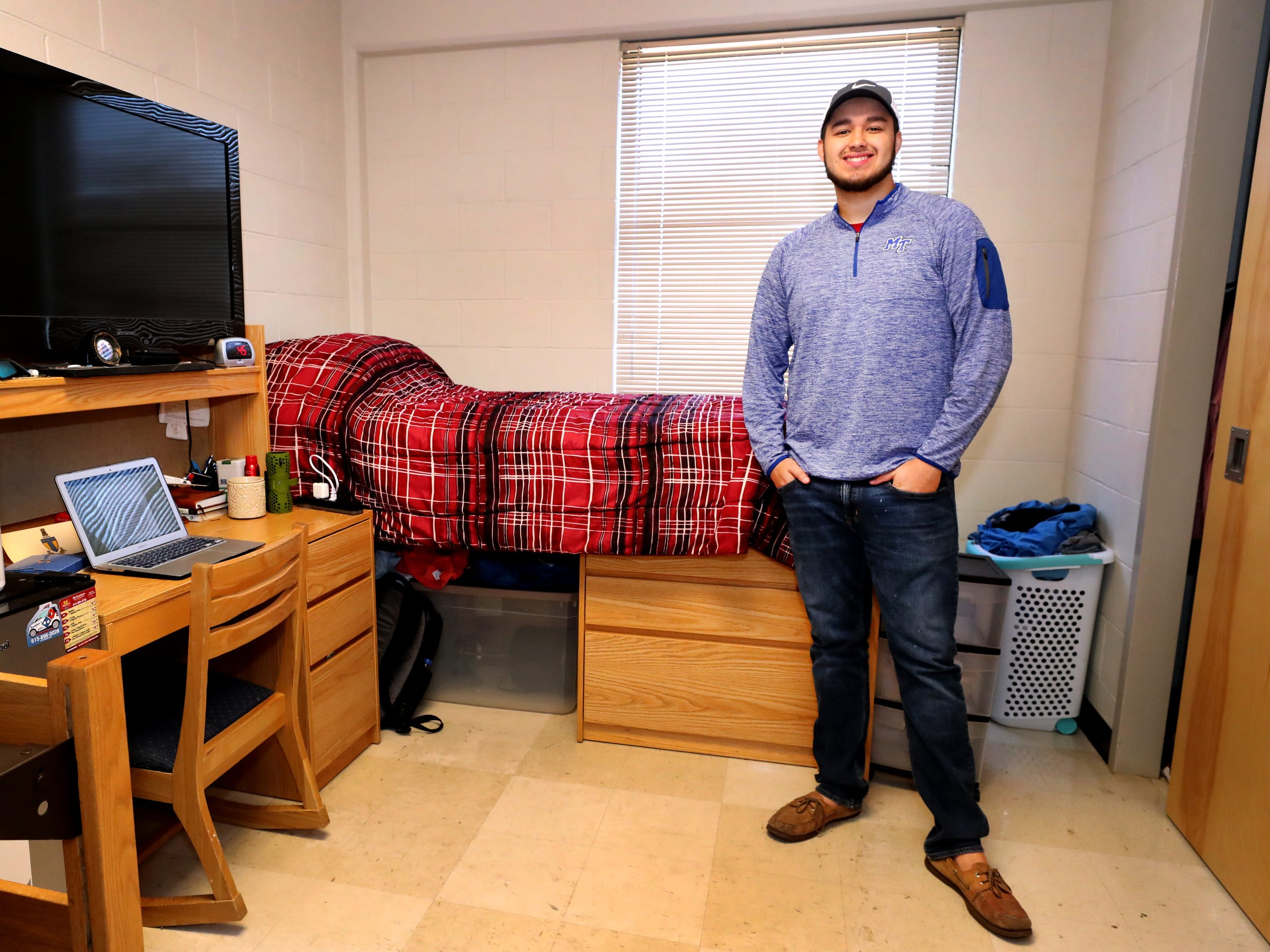 Isaac Plata, a freshman at MTSU, stands in his dorm room in Jim Cummings Hall at MTSU on Friday, March 22, 2019. Plata, who was once homeless, was able to participate in a program at MTSU that makes it easier for former homeless individuals to have a dorm room, while attending college.