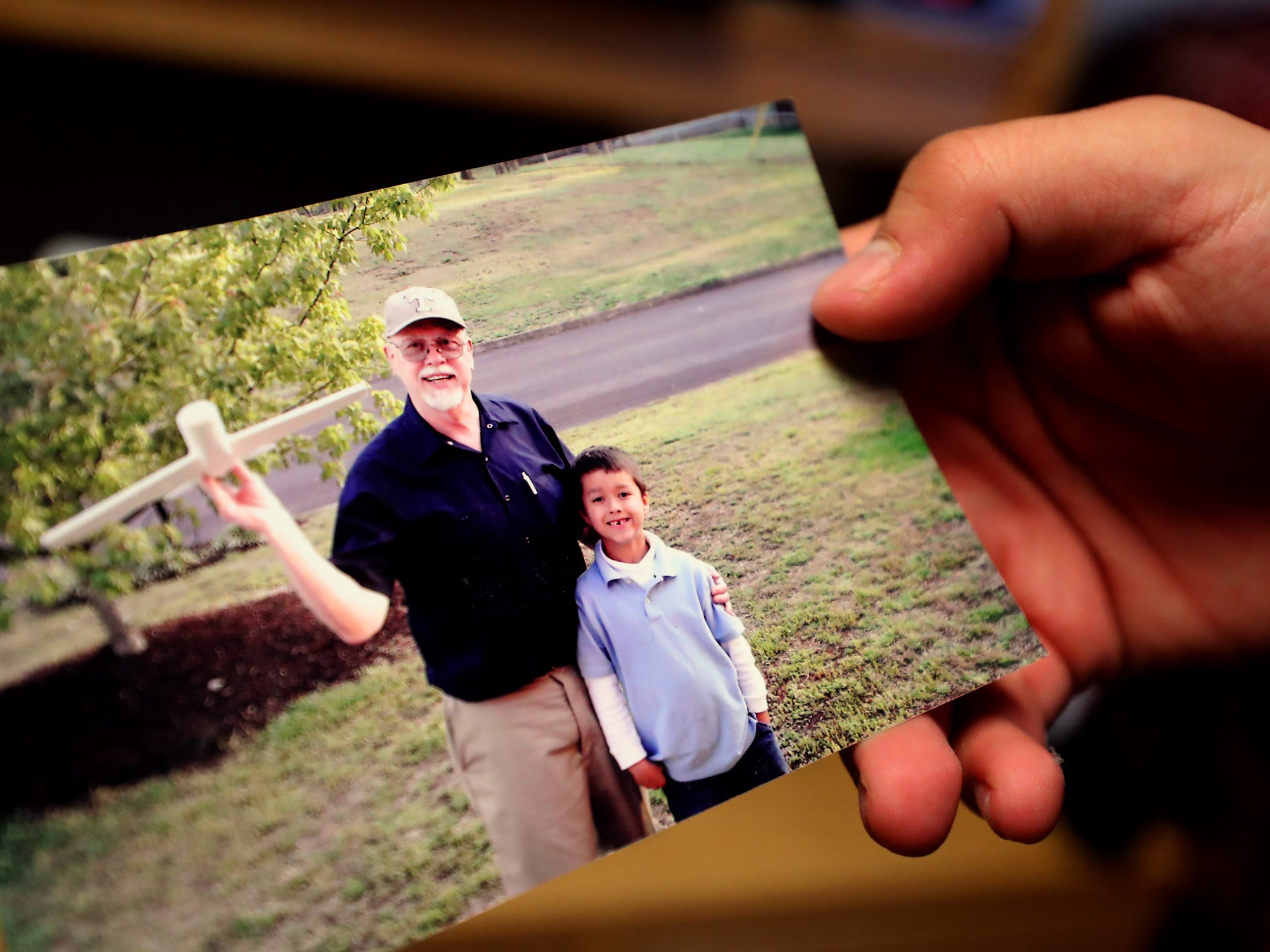 Isaac Plata, an MTSU freshman, holds a picture of himself at about 7 years old with his grandfather Gordon Meis. During some difficult times Plata would live with his grandparents.