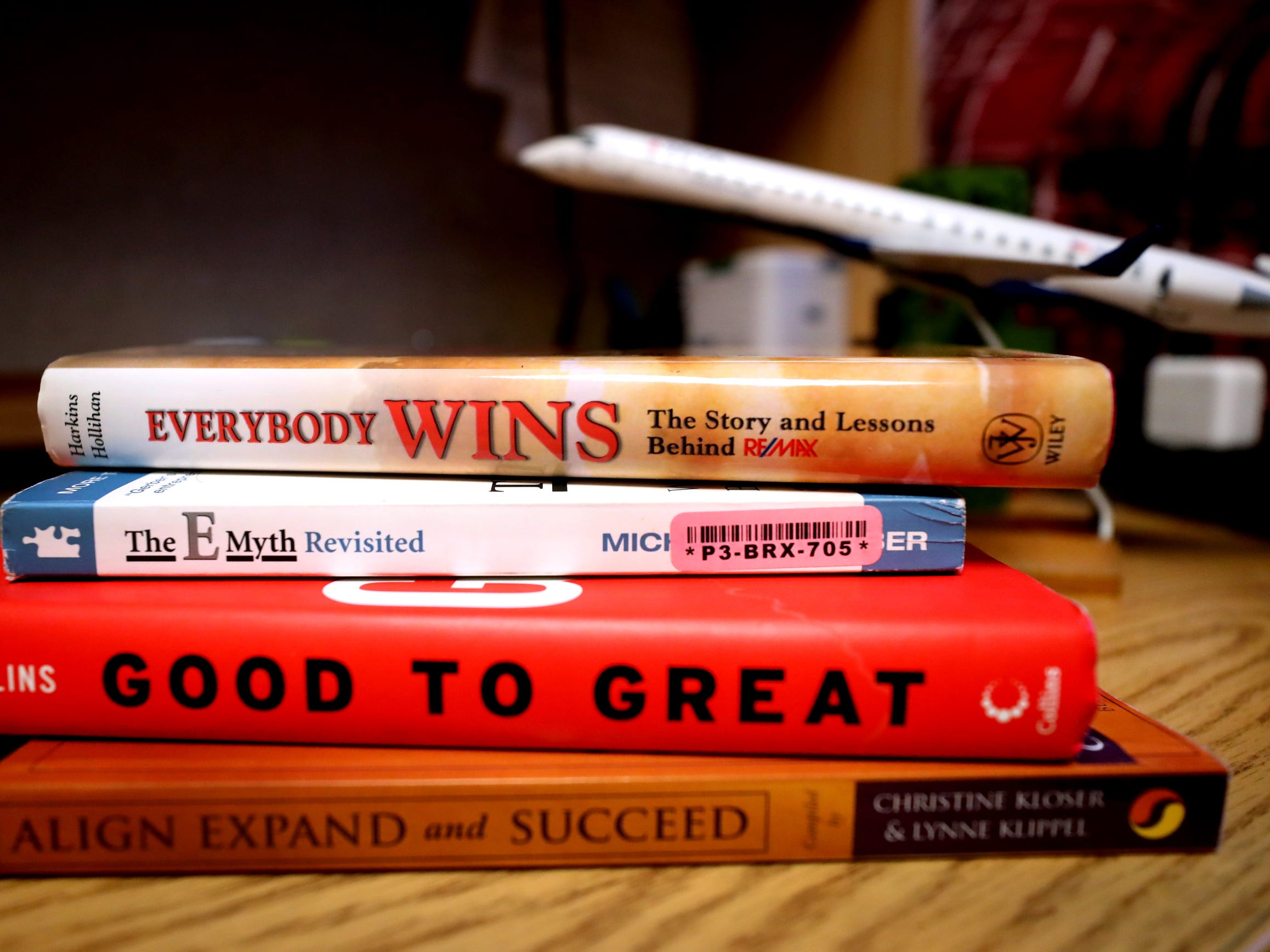 Some of the real estate and marketing books that Isaac Plata now uses in pursuing his new major.