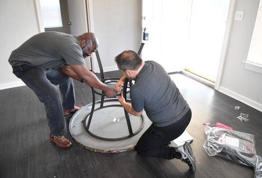 Matthew Charles gets help of his friend Tim Hardiman to put a new table together in his new home. Charles, a former prison inmate who Kim Kardashian offered to pay rent for five years now has a home Saturday, March 23, 2019, in Nashville, Tenn.