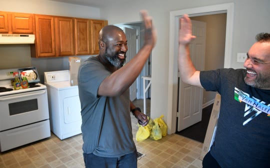 Matthew Charles celebrates moving into his new home with the help of his friend Tim Hardiman.