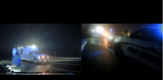 A screenshot of footage from Cheatham County Sheriff's Office Sgt. Paul Ivey's combined dash and body cam show Beth Plant following the deputy around the front of his car on March 9, 2019. This is at 2:02 in the video.