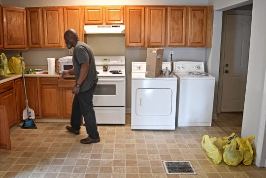 Matthew Charles begins the process of setting up his kitchen at his new place on move-in day.