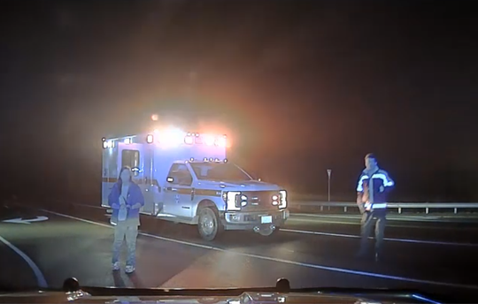A screenshot of footage from Cheatham County Sheriff's Office Sgt. Paul Ivey's dash cam shows Beth Plant standing outside of an ambulance with a knife in her hand on March 9, 2019.