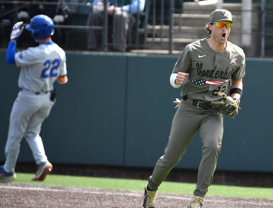 Vanderbilt's Julian Infante (22) gets excited after beating Florida's Cory Acton (22) to the bag as Vanderbilt plays Florida at Hawkins Field Saturday, March 23, 2019, in Nashville, Tenn.