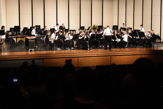 "The Licking County Homeschool Band performs ""Whirling Novas"" by Jack Wilds during a concert and 20-year alumni reunion on Friday at Granville High School."