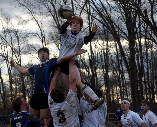 Warrior Rugby senior Beryl Walters wins a line-out against the Hilliard Bears as he is hoisted by teammates Frank Dunn and Elijah Doyle. The Bears defeated the Warriors 18-12 in the Warriors' season opener on Friday, March 22, 2019 at home.