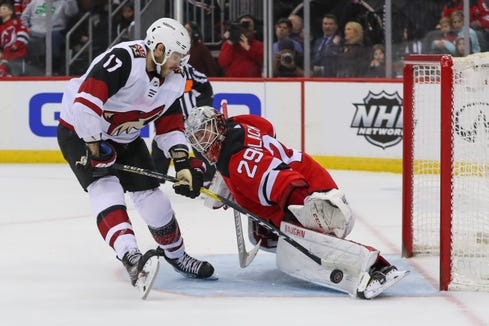 Mar 23, 2019; Newark, NJ, USA; New Jersey Devils goaltender Mackenzie Blackwood (29) makes a save on Arizona Coyotes center Alex Galchenyuk (17) during the shootout at Prudential Center.