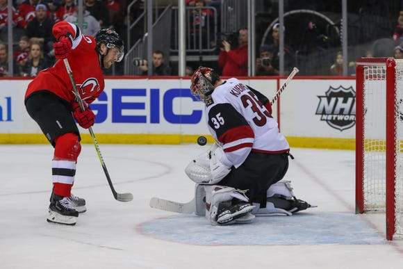 Mar 23, 2019; Newark, NJ, USA; Arizona Coyotes goaltender Darcy Kuemper (35) makes a save against New Jersey Devils center Blake Coleman (20) during the second period at Prudential Center.