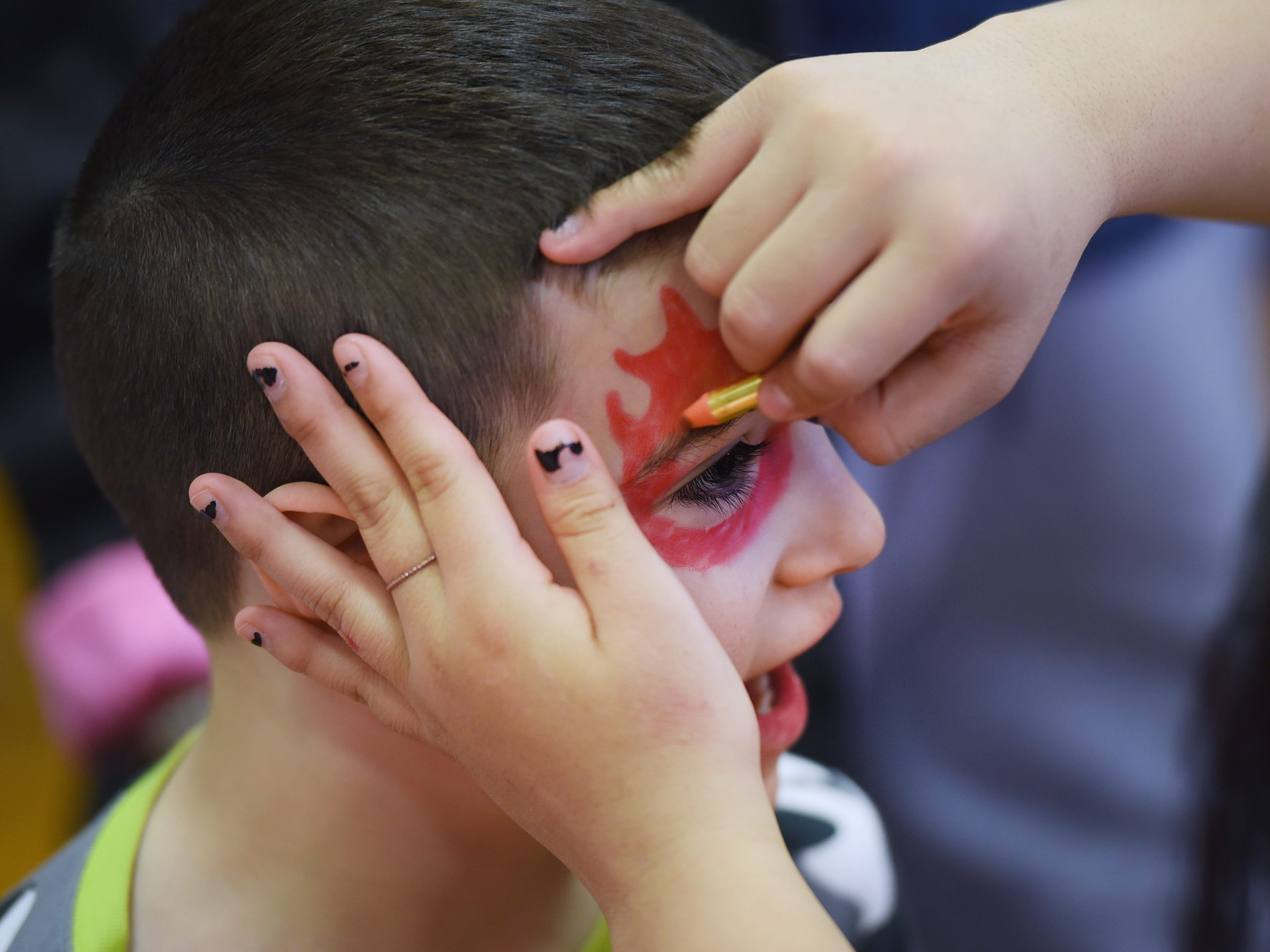 Luke Scano (age 7) of Rutherford has his face painted during the 3rd annual March Madness Food & Fun Day to benefit the Rutherford Food Pantry hosted by the Rutherford Education Association at Washington School in Rutherford on 03/23/2019.