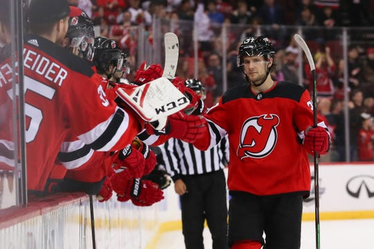 Mar 23, 2019; Newark, NJ, USA; New Jersey Devils center Pavel Zacha (37) celebrates with teammates after scoring a goal during the shootout against the Arizona Coyotes at Prudential Center.