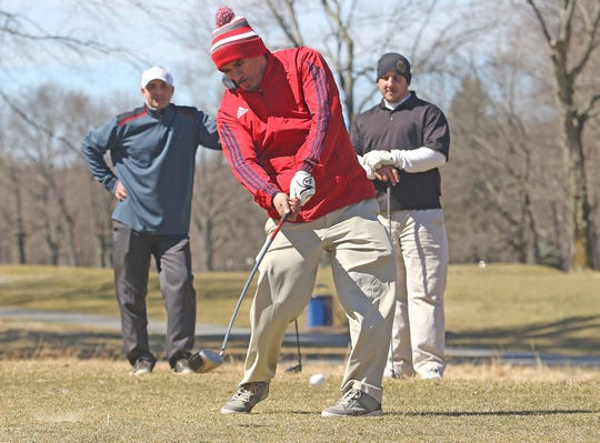 On the first weekend of Spring, Jamal Romero of Nutley and Jay Navarro of Paterson watch Carlos Castoire of Nutley tee off while they braved the wind and cold at the Preakness Valley Passaic County Golf Course in Totowa on March 23, 2019.