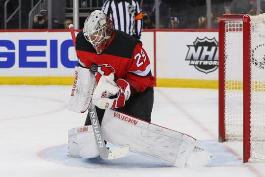Mar 23, 2019; Newark, NJ, USA; New Jersey Devils goaltender Mackenzie Blackwood (29) makes a save during the first period against the Arizona Coyotes at Prudential Center.