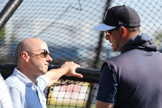 Mar 23, 2019; Tampa, FL, USA; New York Yankees general manager Brian Cashman (left) and manager Aaron Boone (17)  talk prior to the game against the Toronto Blue Jays at George M. Steinbrenner Field.