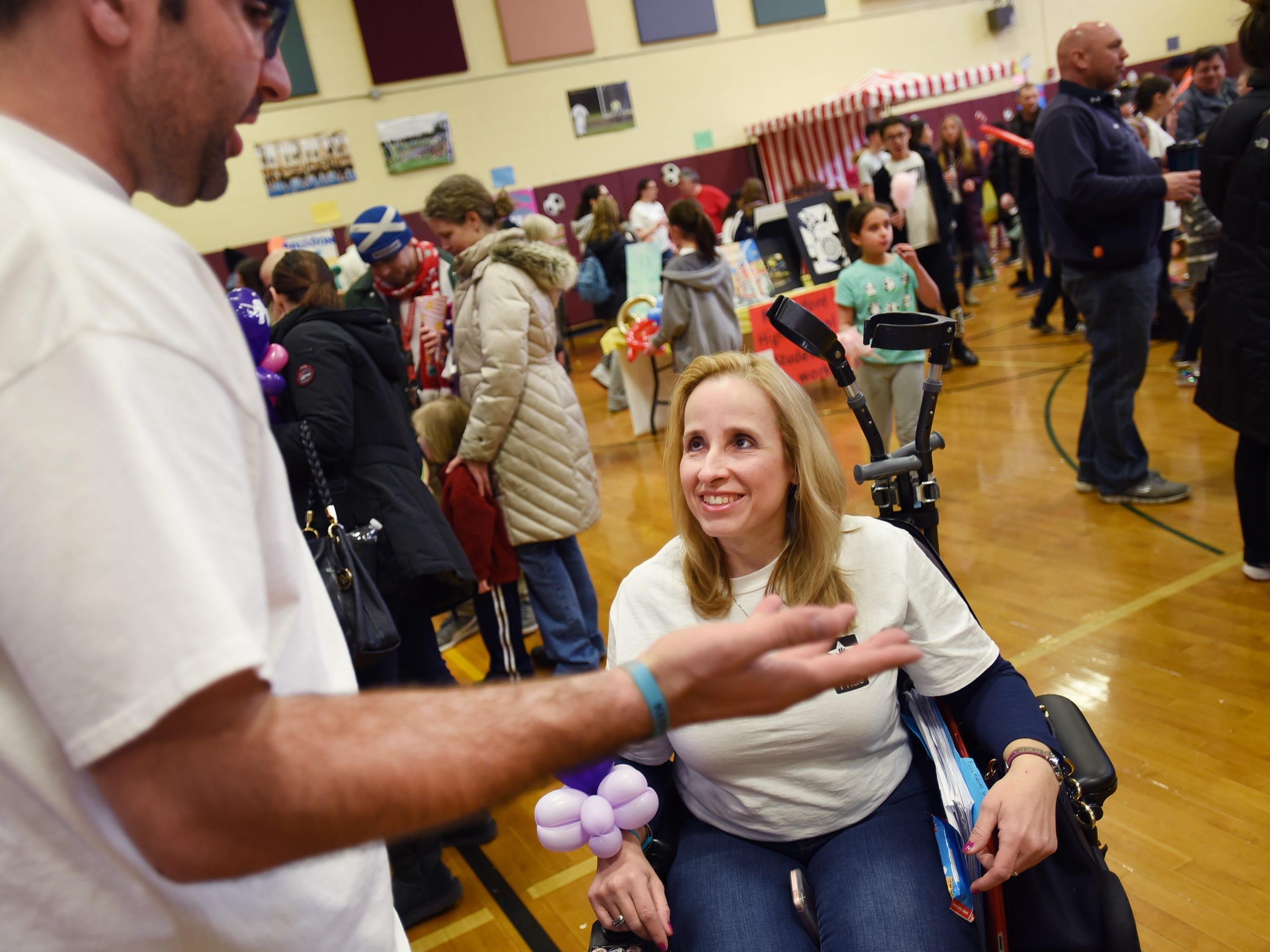 Maria DeTrizio, Co-Chair of The Rutherford Education Association Food and Fun Day 3rd Annual, talks with her Co-Chair Shaun Bach (L) during the 3rd annual March Madness Food & Fun Day to benefit the Rutherford Food Pantry hosted by the Rutherford Education Association at Washington School in Rutherford on 03/23/2019.