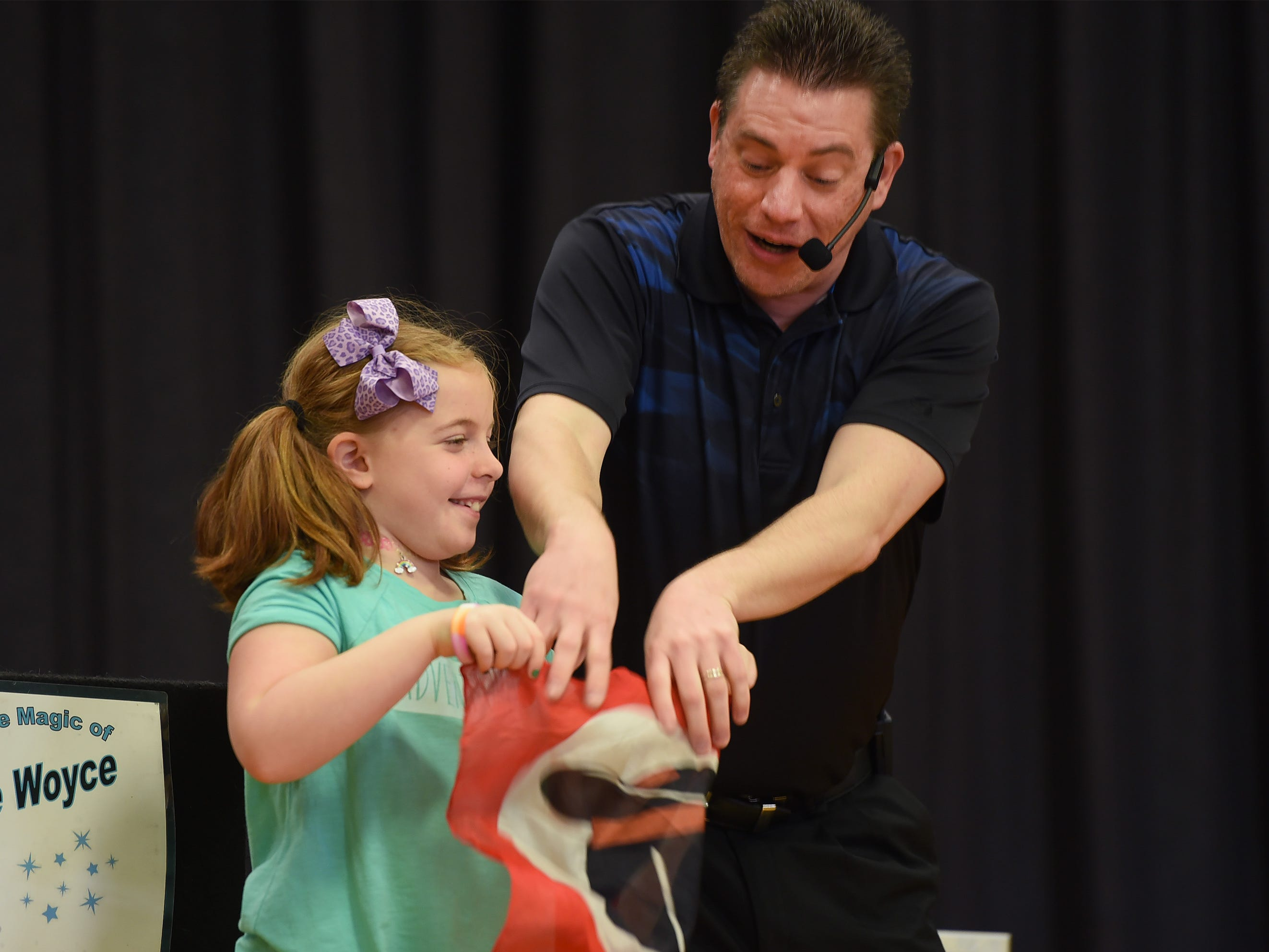 Magician Steve Woyce performs with the help of a little girl during the 3rd annual March Madness Food & Fun Day to benefit the Rutherford Food Pantry hosted by the Rutherford Education Association at Washington School in Rutherford on 03/23/2019.