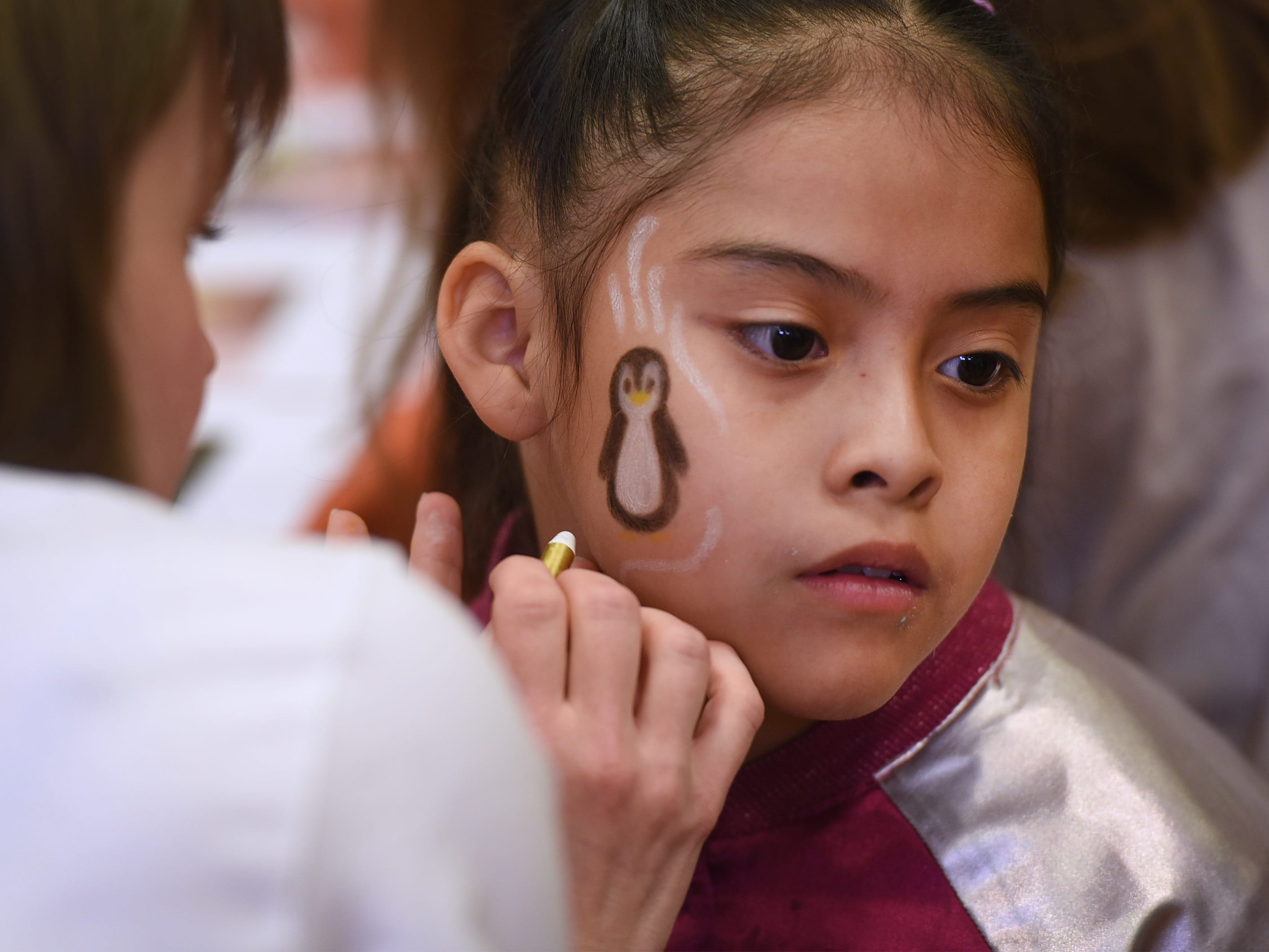 Naralie Marin (age 8) of Rutherford, has her face painted during the 3rd annual March Madness Food & Fun Day to benefit the Rutherford Food Pantry hosted by the Rutherford Education Association at Washington School in Rutherford on 03/23/2019.