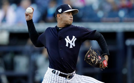 New York Yankees' Jonathan Loaisiga pitches to the Philadelphia Phillies during the first inning of a spring training baseball game Friday, March 22, 2019, in Tampa, Fla.