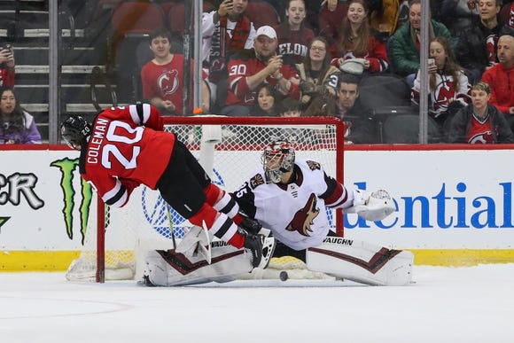 Mar 23, 2019; Newark, NJ, USA; New Jersey Devils center Blake Coleman (20) scores a goal on Arizona Coyotes goaltender Darcy Kuemper (35) during the shootout at Prudential Center.