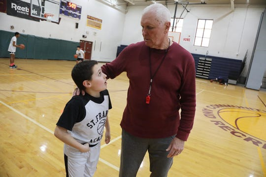 Here is Bob Hurley and his grandson Gabe Ursic 9 at the end of basketball practice. 