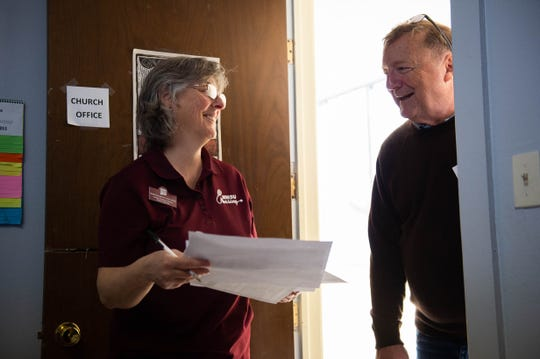 Randee Greenwald, New Mexico State University assistant professor in the School of Nursing, College of Health and Social Services, left, talks with George Miller, pastor at El Calvario United Methodist Church, before seeing asylum seeker, looking for some health services, Monday, March 18, 2019.