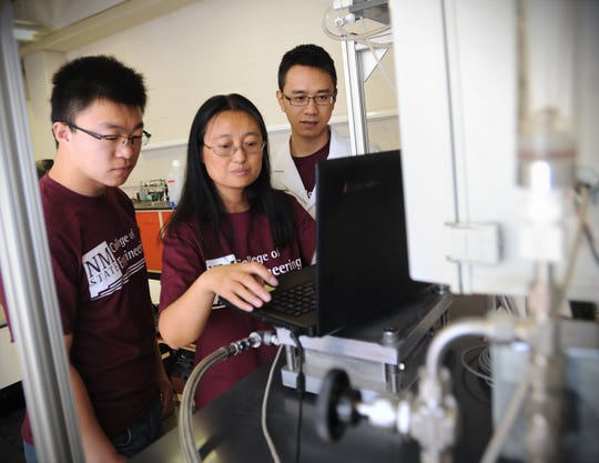 Pei Xu, center, New Mexico State University civil engineering associate professor, seen here in 2014, is leading NMSU's effort as a member of the National Alliance for Water Innovation team in pursuit of a $100 million grant from the U.S. Department of Energy to create a new Energy-Water Desalination Hub.
