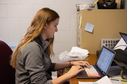 Josie Schmidt, a social work graduate student at New Mexico State University, works to find social service programs and make travel arrangements for the asylum seekers that pass through El Calvario Methodist Church on Monday, March 18, 2019.