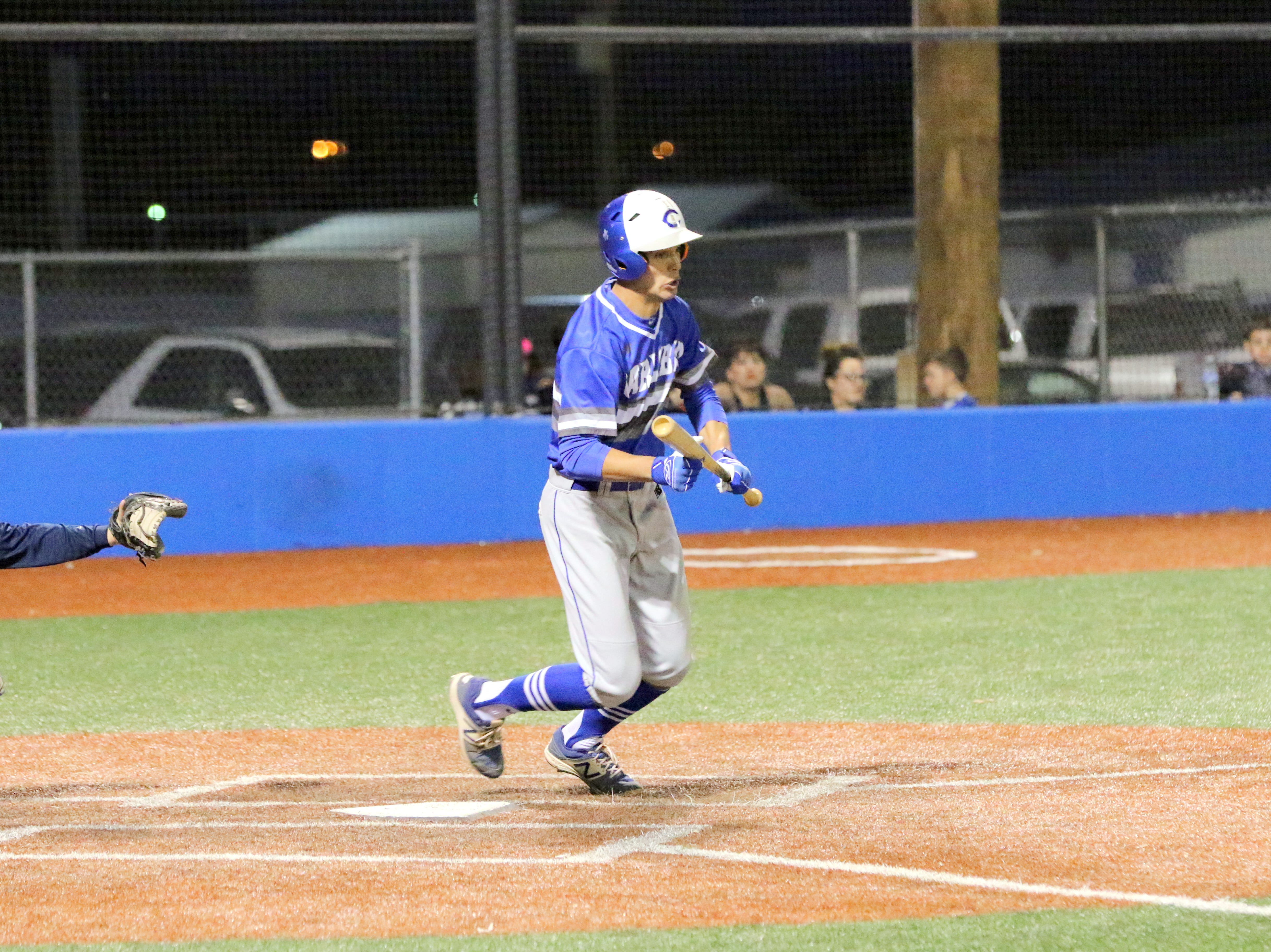 Will Garza looks at a pitch before dropping a bunt against Ruidoso on Friday.