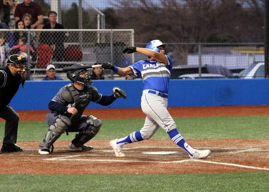 Trey Castenada swings through a pitch against Ruidoso. He was 3-for-3 with an inside-the-park-homer in the win.