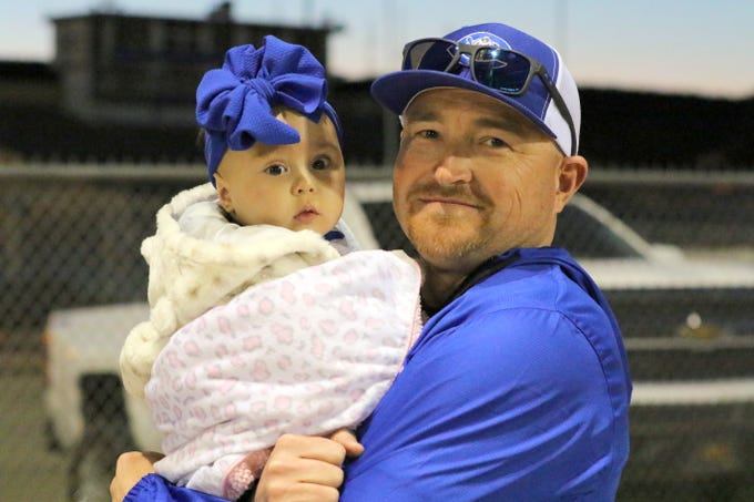 A young Carlsbad fan takes a break from Friday's action against Ruidoso. Carlsbad won, 10-0 in six innings.