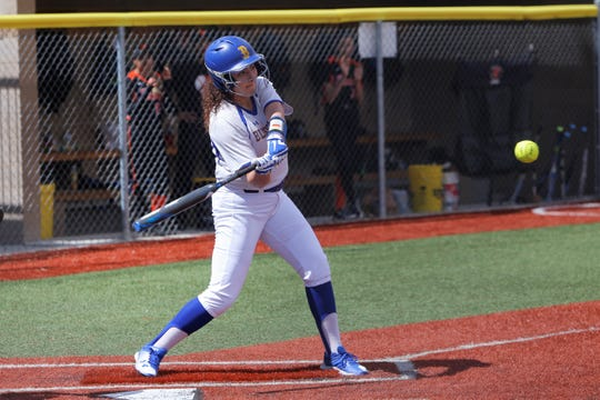 Bloomfield's Acacia Bell hits an RBI-double against Taos during Saturday's game at Bloomfield Softball Complex.