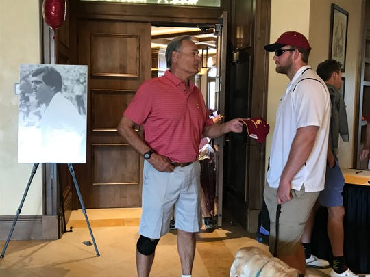 Jake Olson chats with USC alumnus Bill Adams at the 17th annual Trojan Athletic Fund Club of The Desert Golf Classic in Palm Desert. Adams was part of the 1967 USC Trojans that won the national title.
