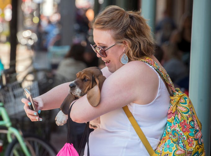 "Liz Cooper takes a photo with ""Margo"" Saturday, March 23, 2019 during Ciclovia - Pensacola Open Streets, a unique event in downtown Pensacola where the streets are closed to motor traffic and open for biking, walking, dancing and relaxing."