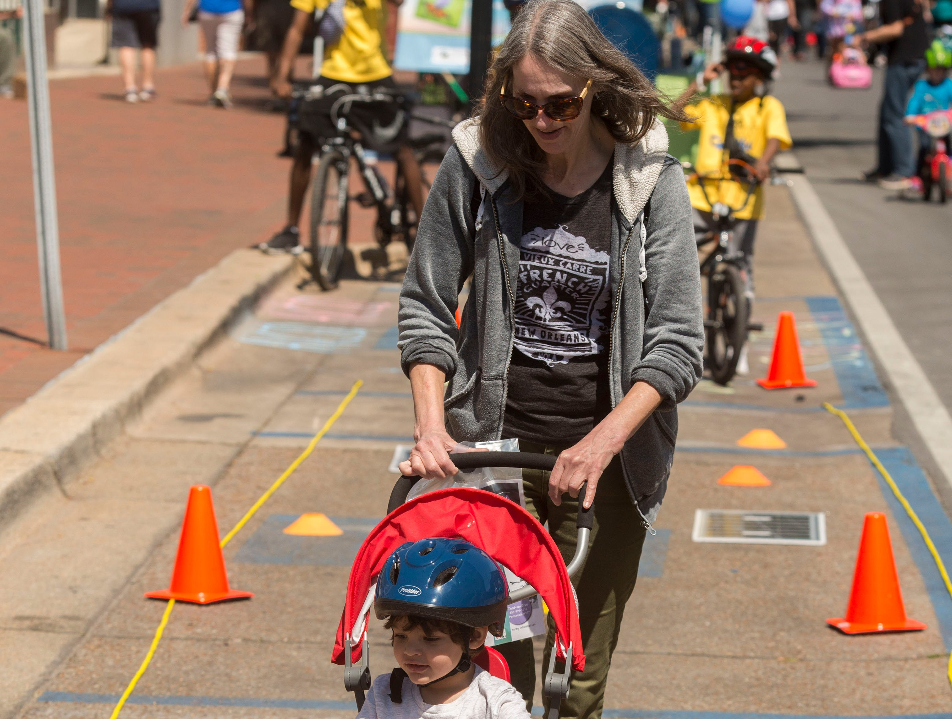 The crowd takes in the activities Saturday, March 23, 2019 during Ciclovia - Pensacola Open Streets, a unique event in downtown Pensacola where the streets are closed to motor traffic and open for biking, walking, dancing and relaxing.