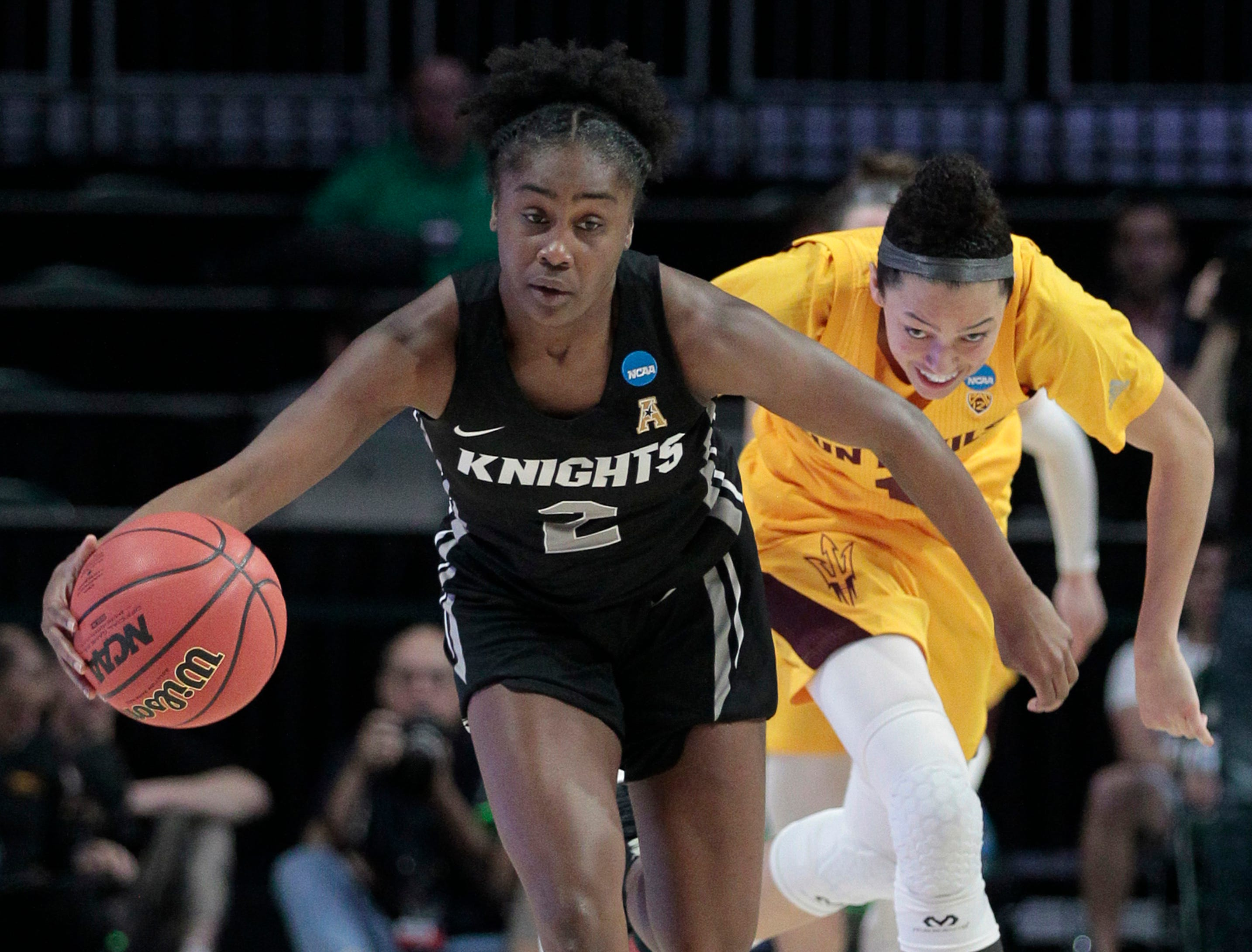UCF guard Kay Kay Wright (2) gets control of a loose ball as Arizona State guard Reili Richardson (1) pursues, during a first round women's college basketball game in the NCAA Tournament in Friday, March 22, 2019, in Coral Gables, Fla. (AP Photo/Luis M. Alvarez)