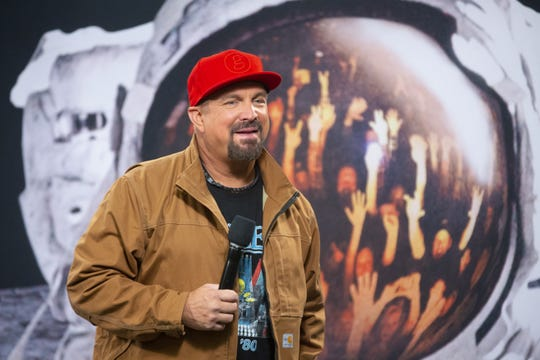 Garth Brooks speaks during a press conference at State Farm Stadium in Glendale on March 22, 2019. Brooks will be performing before a record-breaking crowd of 75,000 on March 23.