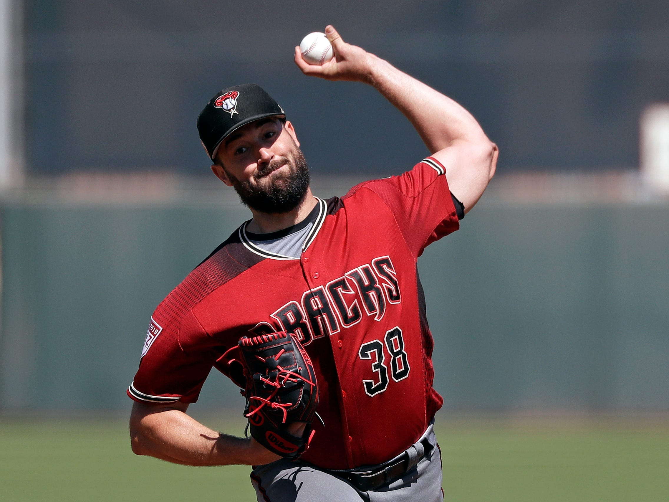 Arizona Diamondbacks starting pitcher Robbie Ray throws against the San Francisco Giants in the first inning of a spring training baseball game Saturday, March 23, 2019, in Scottsdale, Ariz.