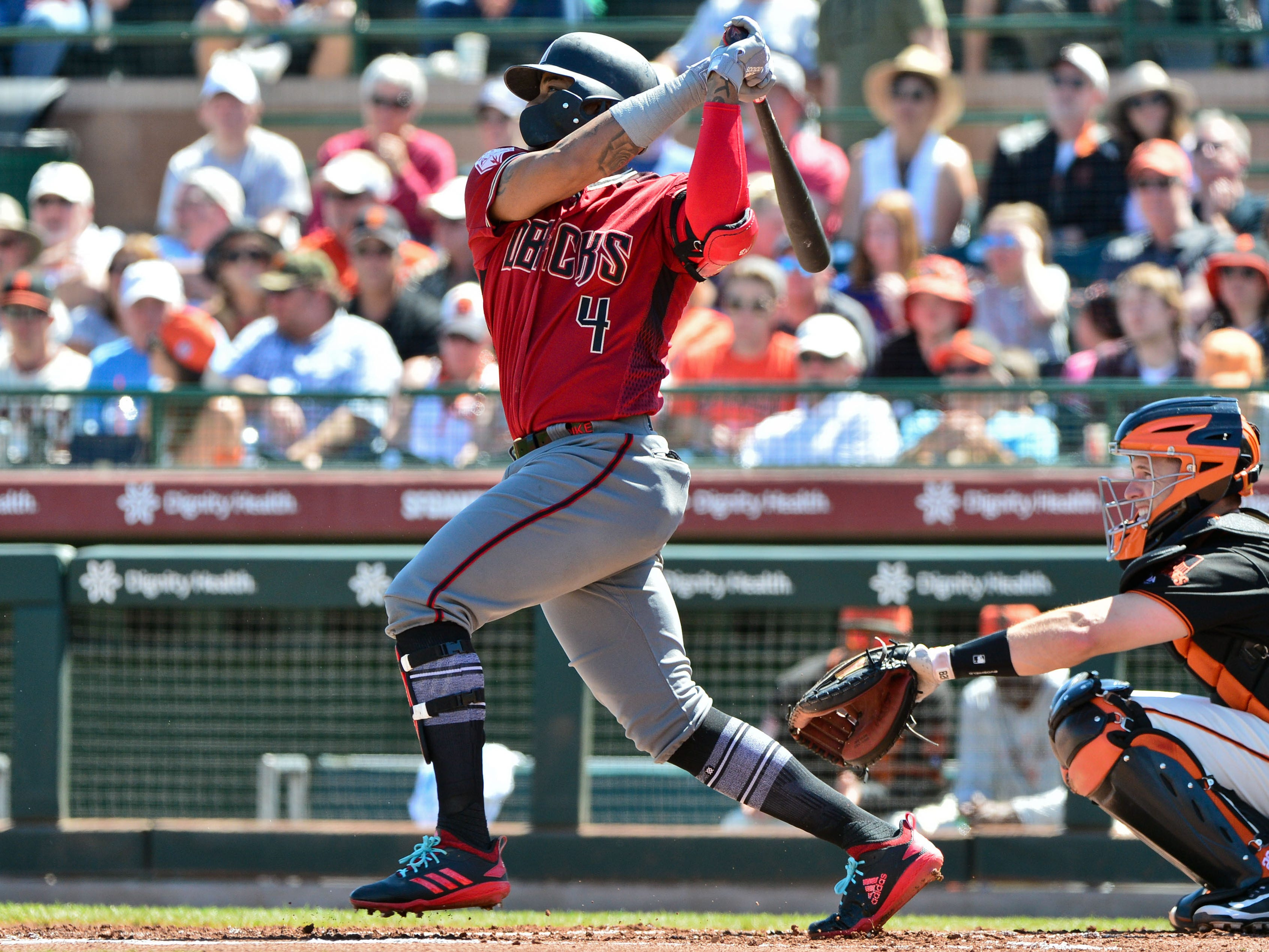 Mar 23, 2019; Scottsdale, AZ, USA; Arizona Diamondbacks shortstop Ketel Marte (4) singles in the first inning against the San Francisco Giants at Scottsdale Stadium.