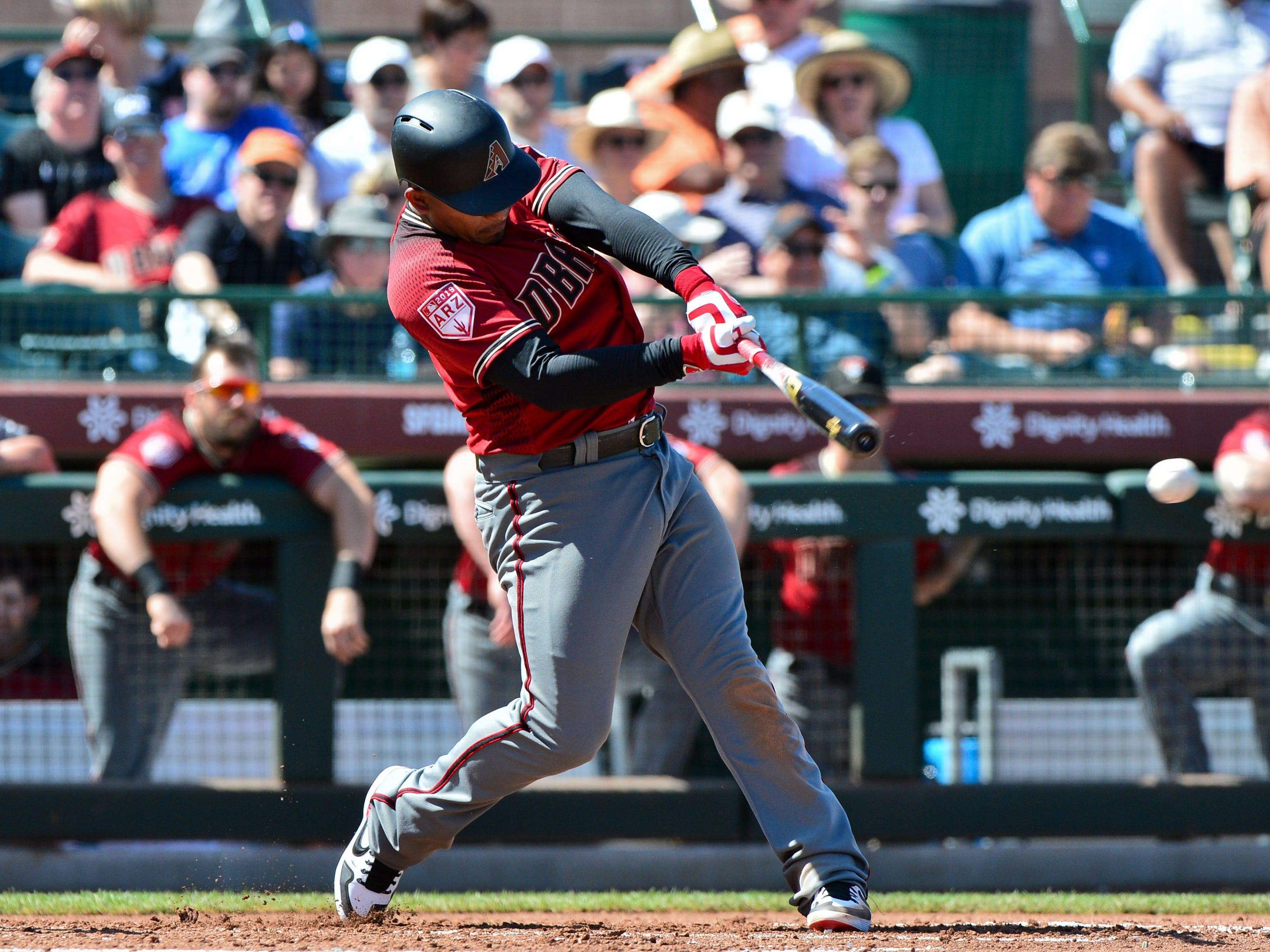 Mar 23, 2019; Scottsdale, AZ, USA; Arizona Diamondbacks third baseman Eduardo Escobar (5) singles in the third inning against the San Francisco Giants at Scottsdale Stadium.