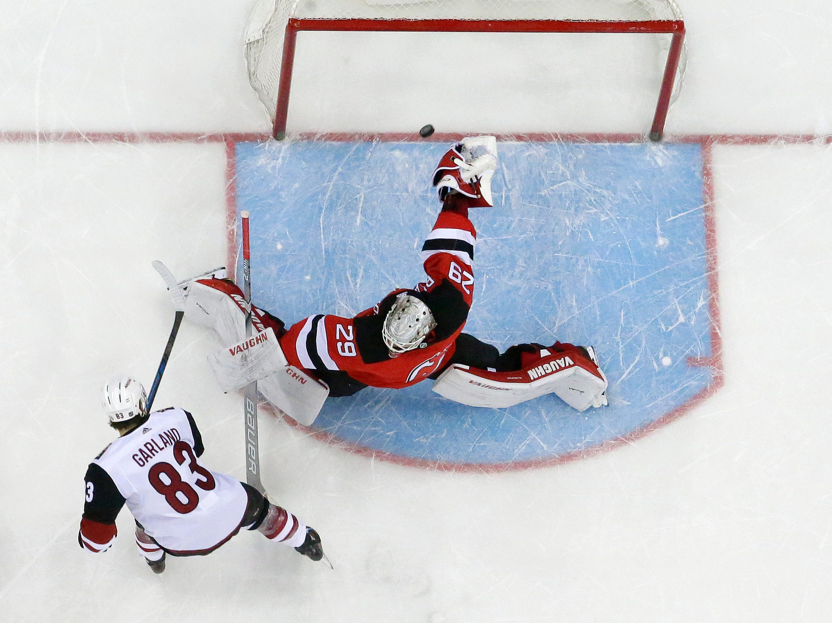 Arizona Coyotes right wing Conor Garland (83) scores a shootout goal on New Jersey Devils goaltender MacKenzie Blackwood (29) during during an NHL hockey game, Saturday, March 23, 2019, in Newark, N.J. The Devils on 2-1 in a shootout.