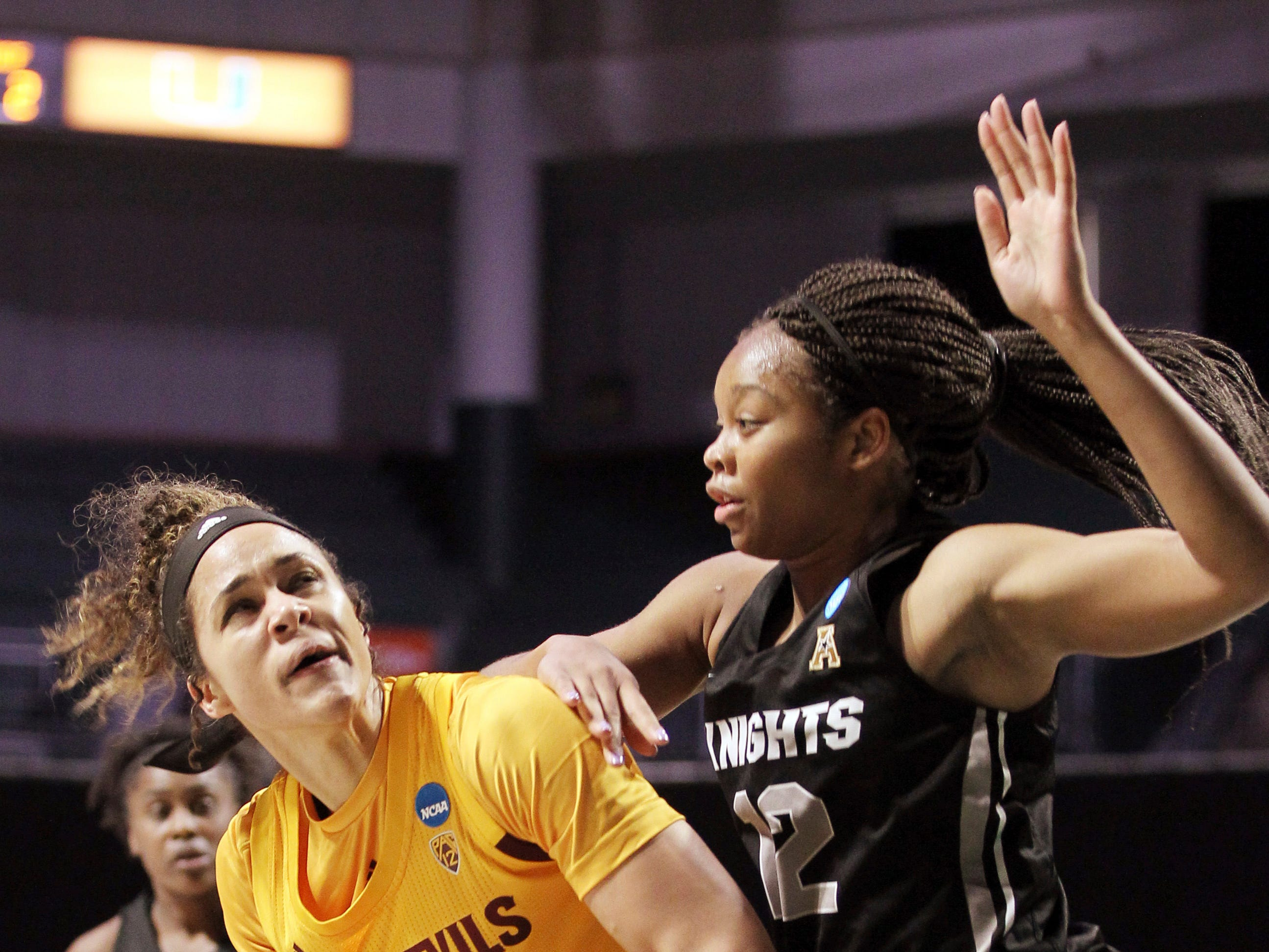 UCF forward Nyala Shuler (12) defends Arizona State forward Kianna Ibis (42), during a first round women's college basketball game in the NCAA Tournament in Friday, March 22, 2019, in Coral Gables, Fla. (AP Photo/Luis M. Alvarez)