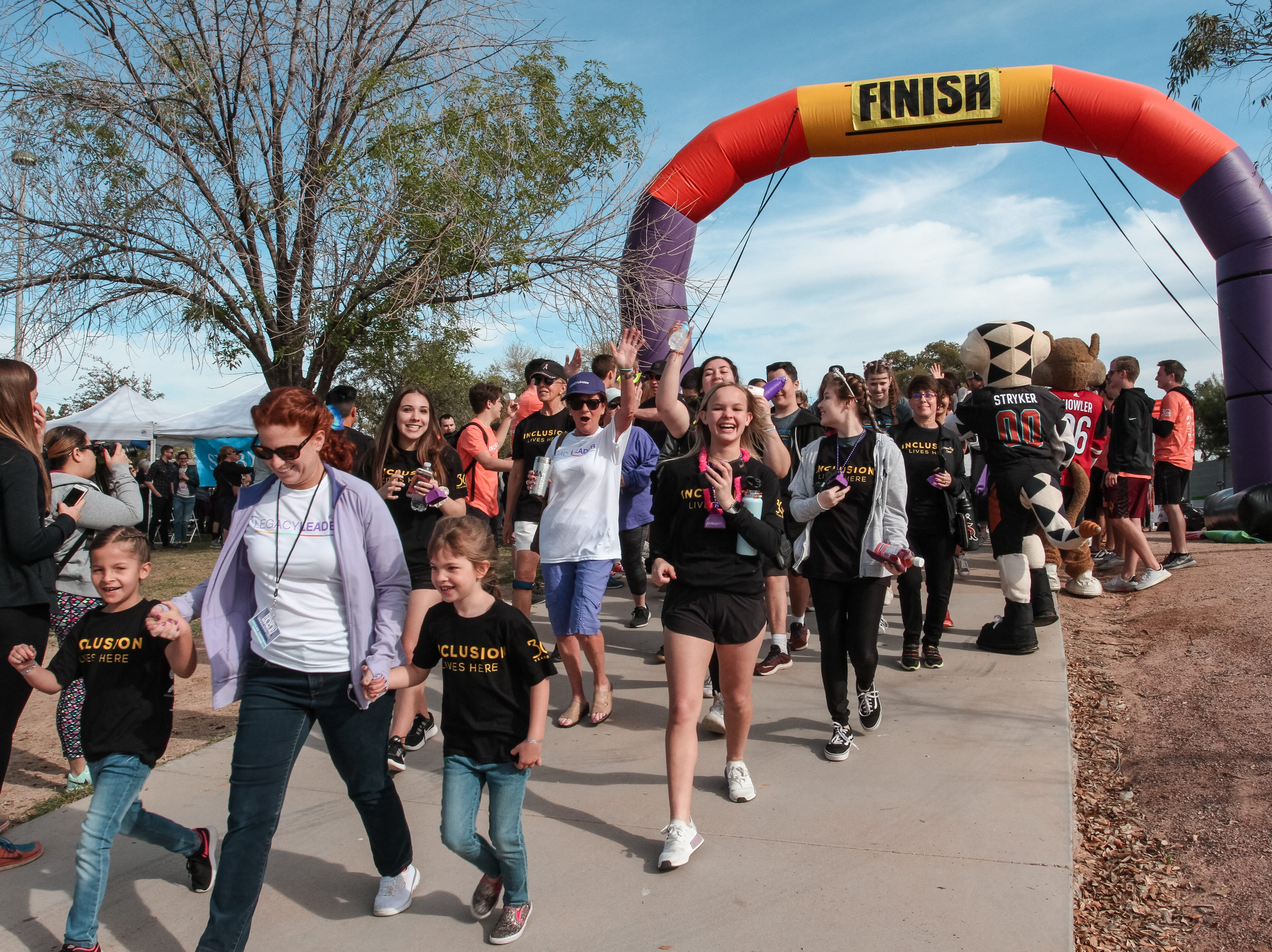 Participants begin walking at The Best Buddies Friendship Walk at Kiwanis Park in Tempe on March 23, 2019.
