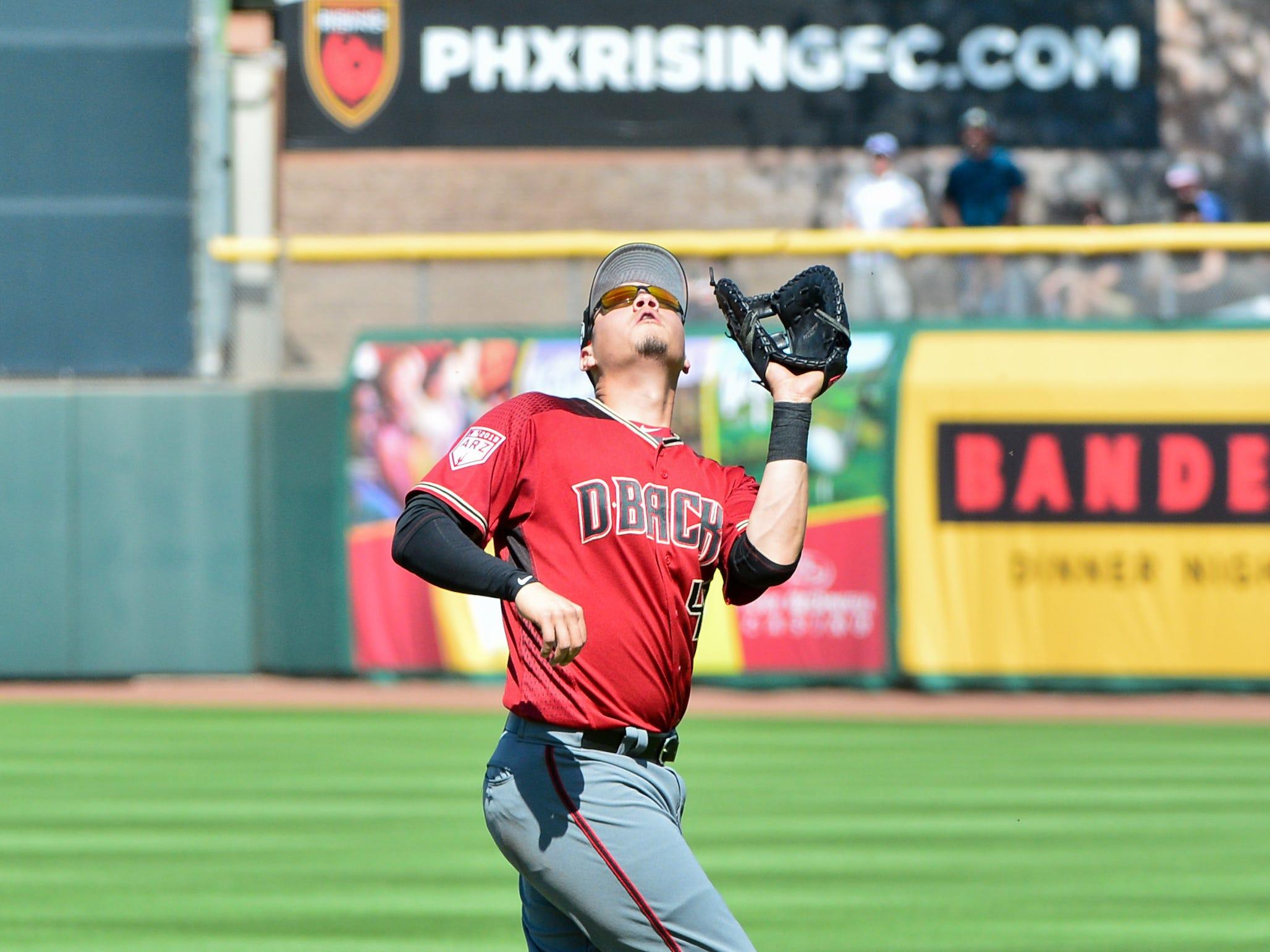 Mar 23, 2019; Scottsdale, AZ, USA; Arizona Diamondbacks third baseman Wilmer Flores (41) catches a fly ball during the third inning against the San Francisco Giants at Scottsdale Stadium.