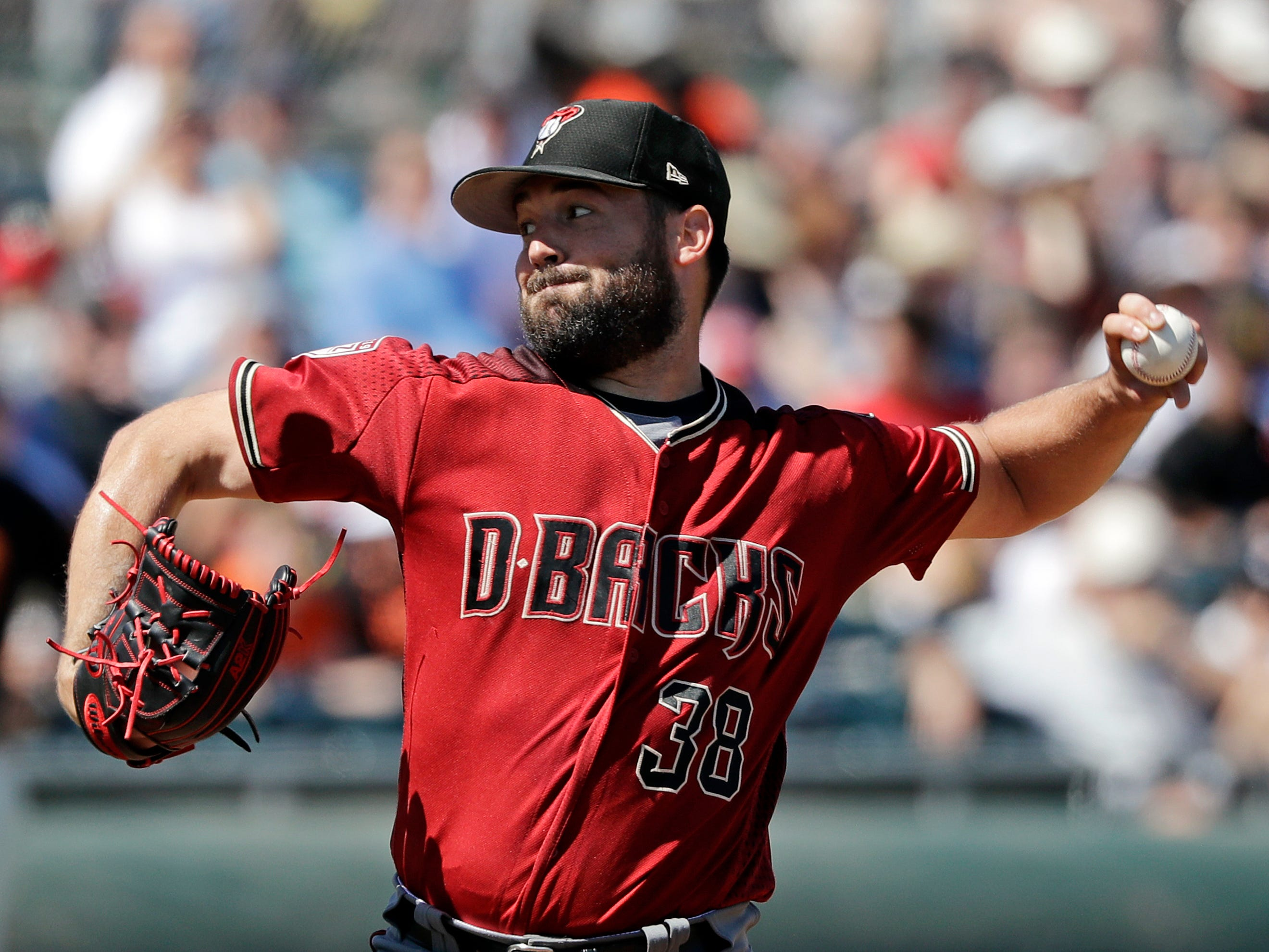 Arizona Diamondbacks starting pitcher Robbie Ray throws against the San Francisco Giants in the second inning of a spring training baseball game Saturday, March 23, 2019, in Scottsdale, Ariz.