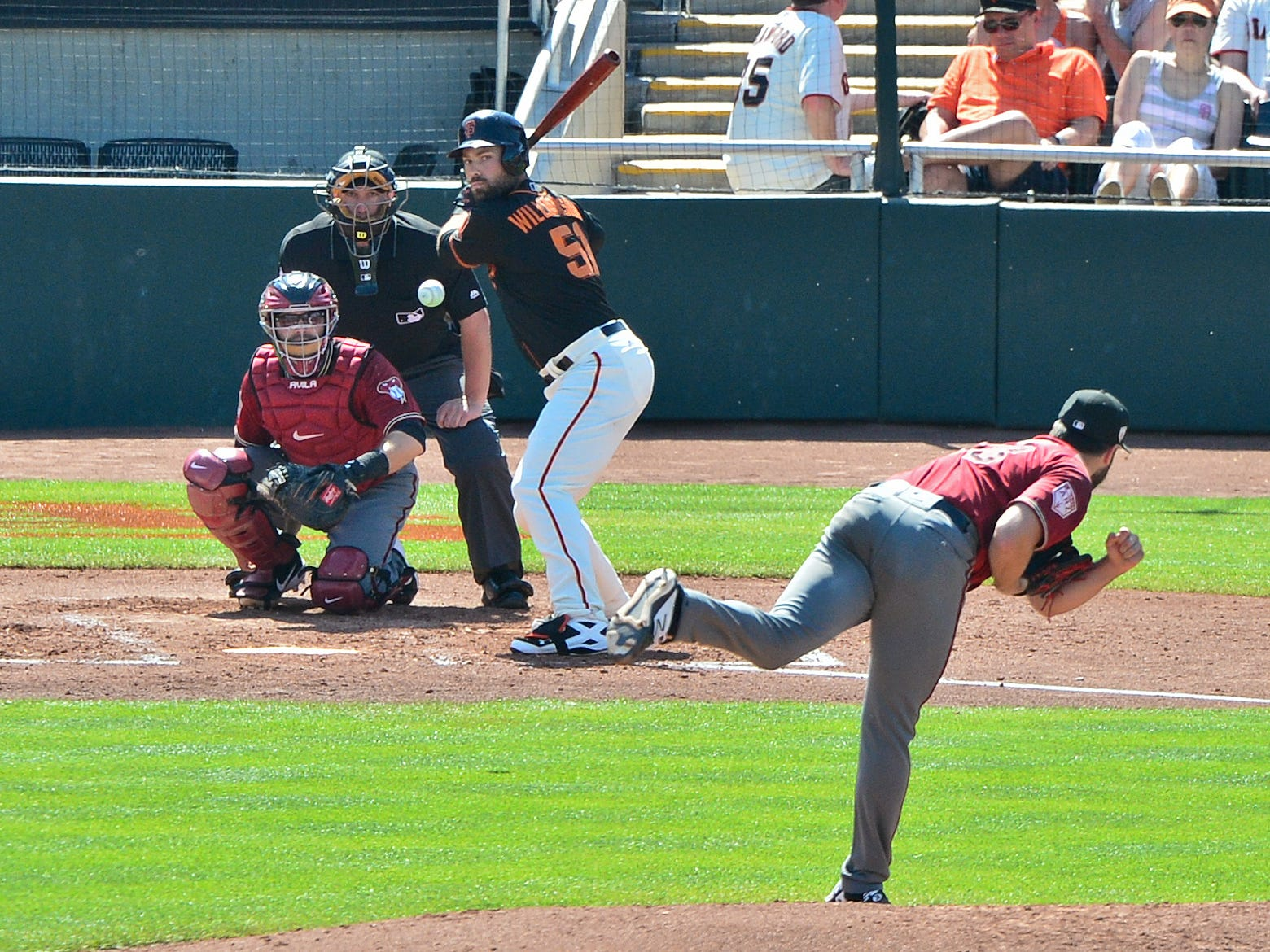 Mar 23, 2019; Scottsdale, AZ, USA; Arizona Diamondbacks starting pitcher Robbie Ray (38) throws to San Francisco Giants left fielder Mac Williamson (51) during the fourth inning at Scottsdale Stadium.
