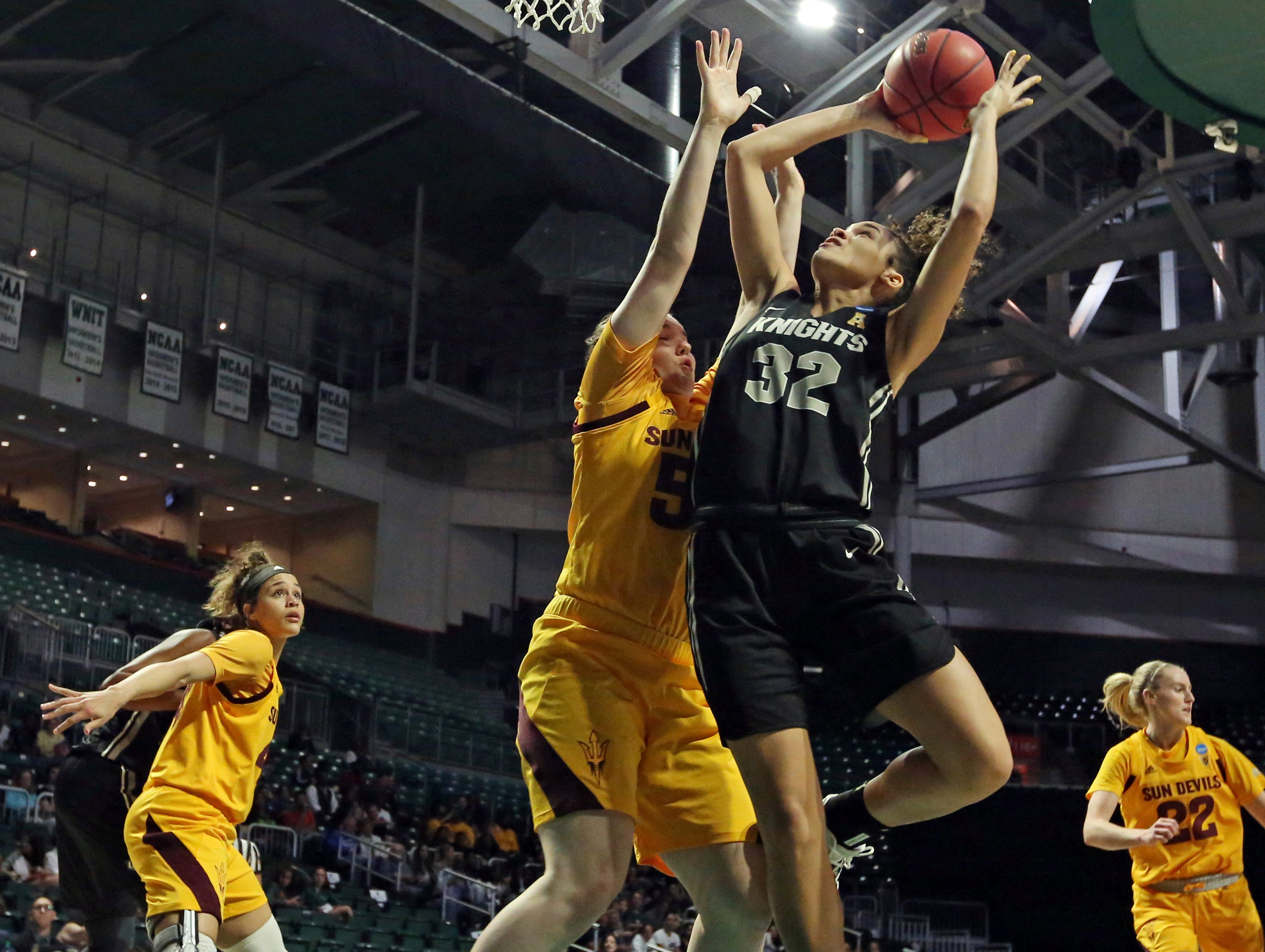 UCF forward Brittney Smith (32) drives to the basket around Arizona State forward Jamie Ruden (52), during a first round women's college basketball game in the NCAA Tournament in Friday, March 22, 2019, in Coral Gables, Fla. (Al Diaz/The Miami Herald via AP)