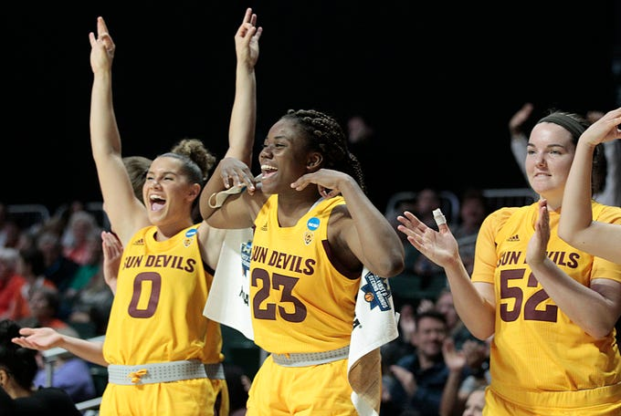 Arizona State guard Taya Hanson (0), guard Iris Mbulito (23) and forward Jamie Ruden (52), celebrate after defeating UCF 60-43, during a first round women's college basketball game in the NCAA Tournament in Friday, March 22, 2019, in Coral Gables, Fla. (AP Photo/Luis M. Alvarez)