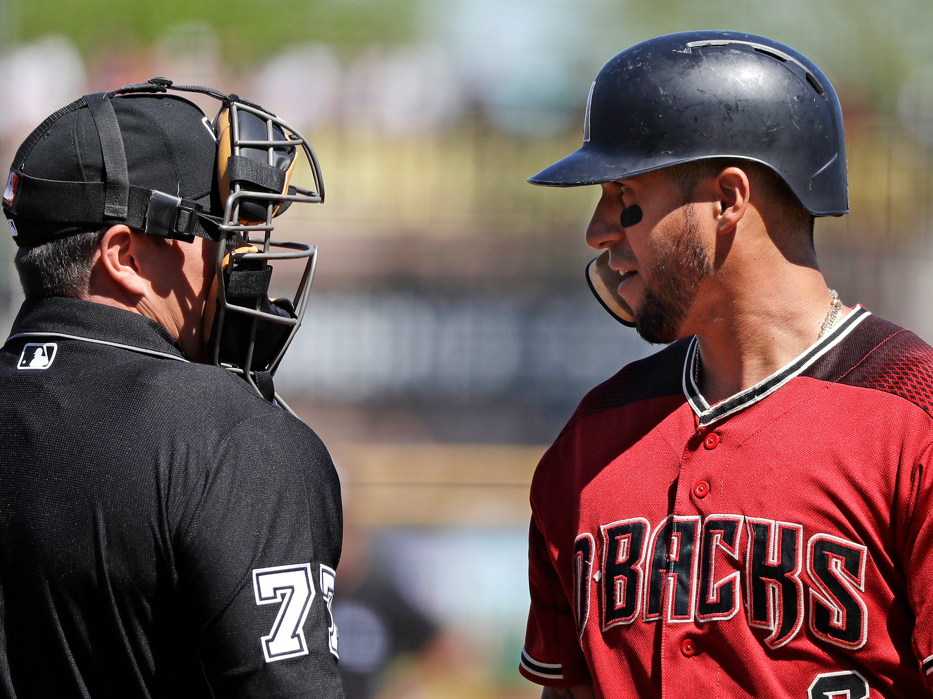 Arizona Diamondbacks' David Peralta, right, turns to talk with umpire Sean Ryan after being called out on strikes looking in the first inning of a spring training baseball game against the San Francisco Giants, Saturday, March 23, 2019, in Scottsdale, Ariz.