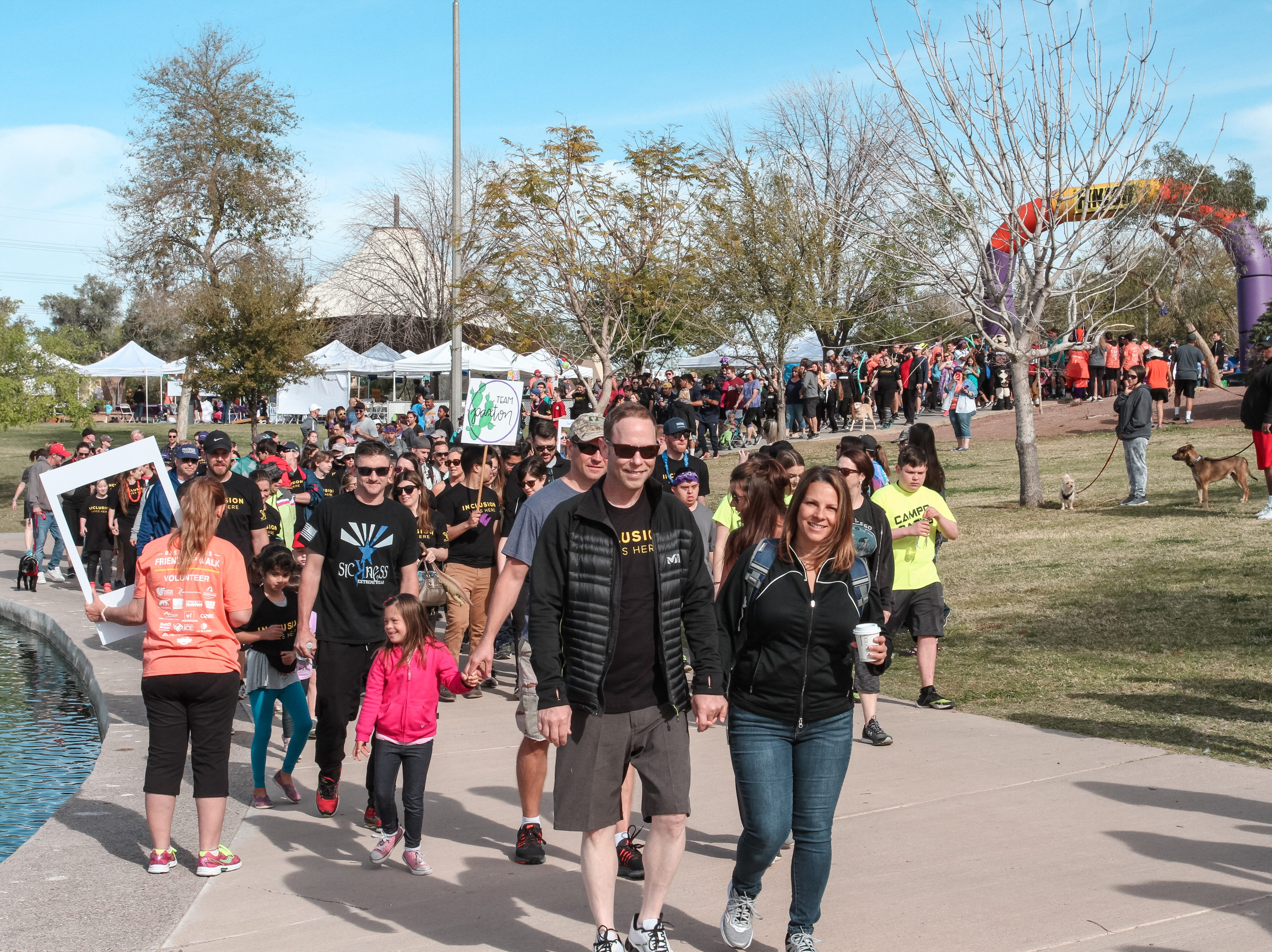 Participants walk at The Best Buddies Friendship Walk at Kiwanis Park in Tempe on March 23, 2019.